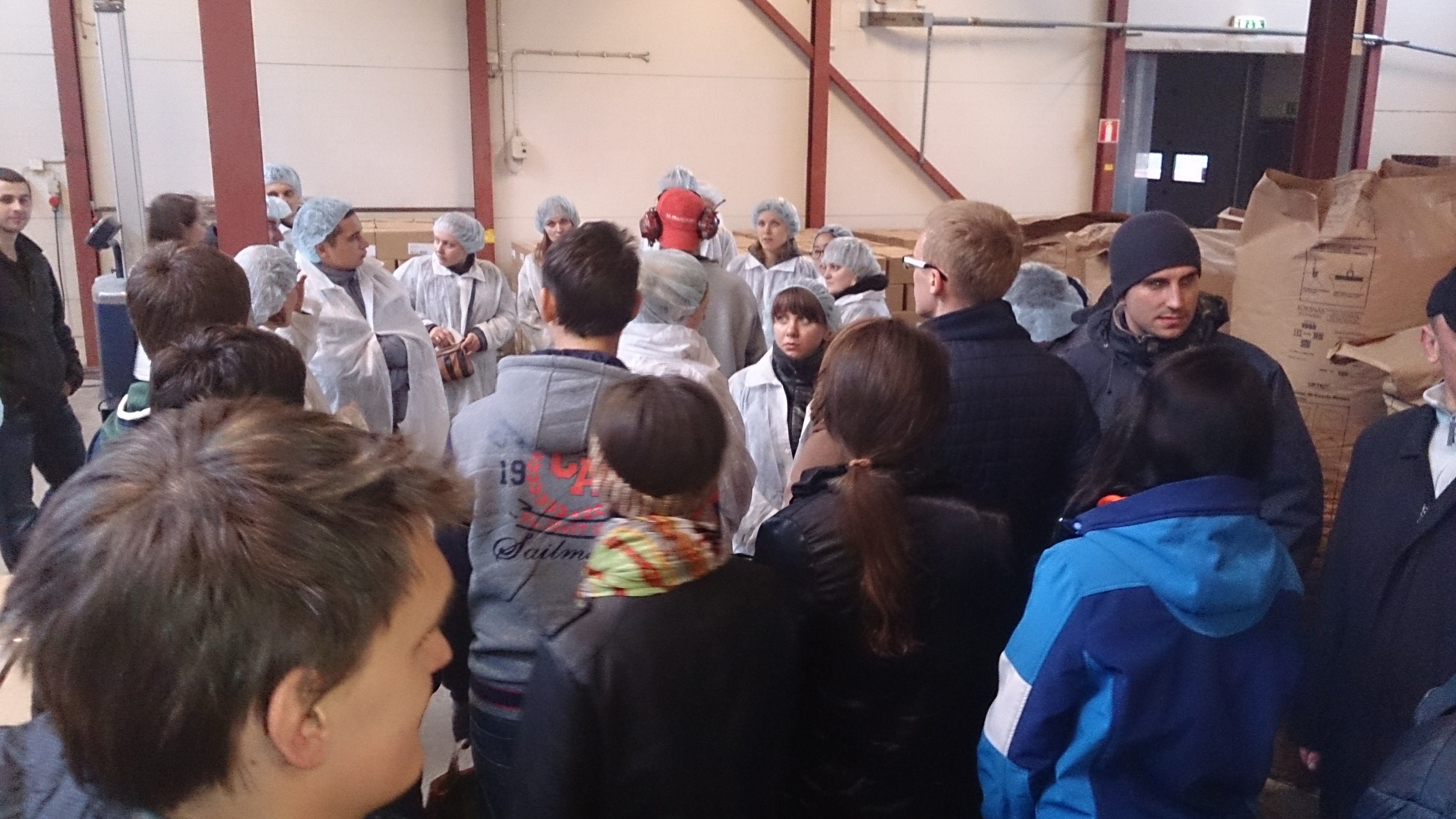 In Saltå Mill, one group finished taking of safety clothes, other group take the clothes on.