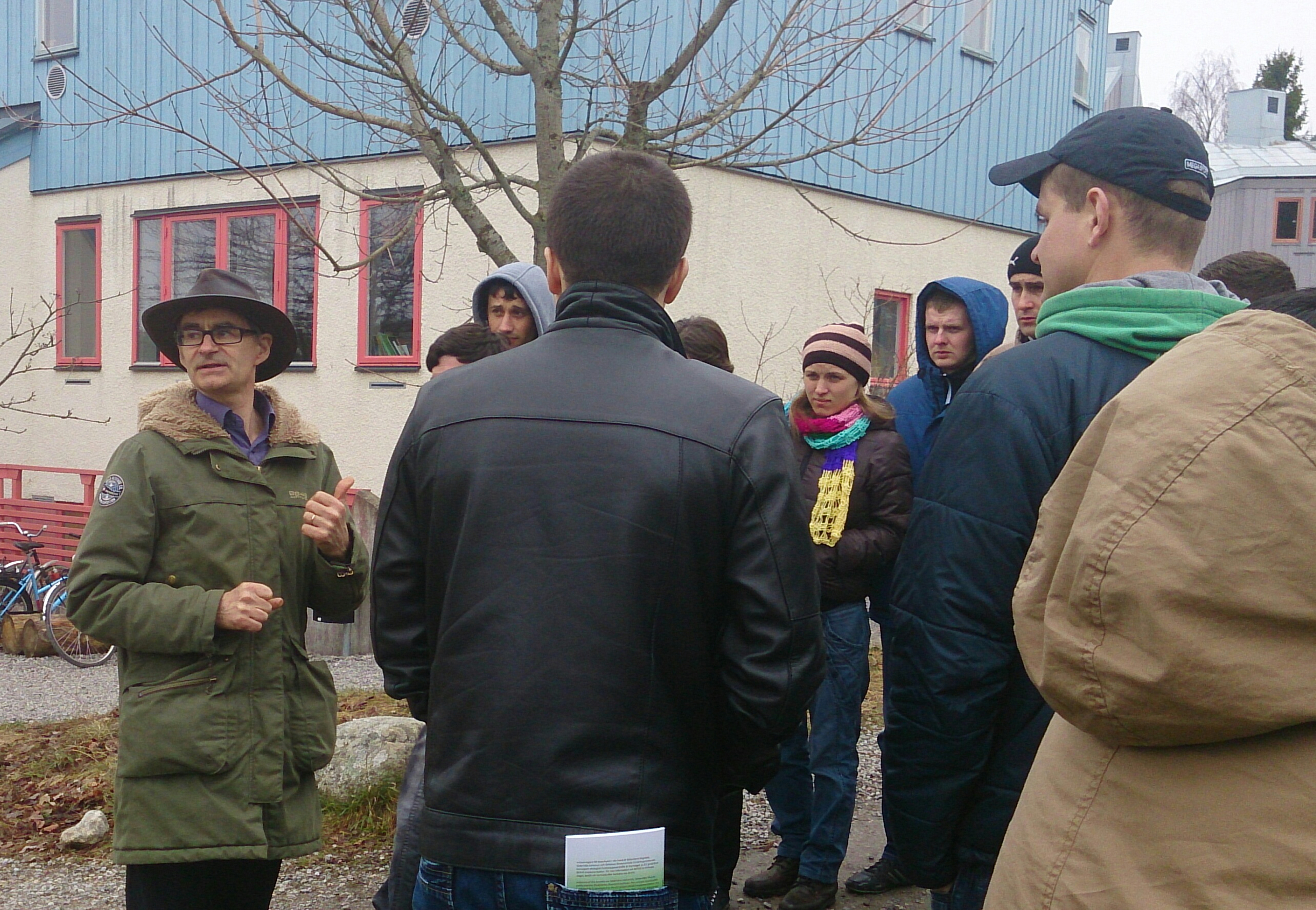 Hans von Essen take a walk with all trainees and showing Beras International outside.